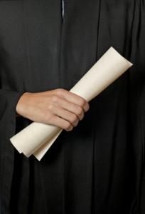 hand holding diploma